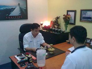Kenny wong sets up setrap at office