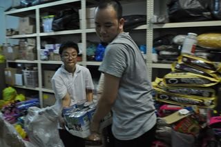 08 - unloading the food to the kechara store room