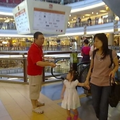 Lew tirelessly giving out KSK leaflets by the escalator in One Utama