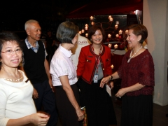 Datuk May (President of Kechara House) greeting Mama How.