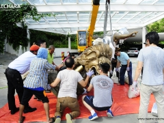 Laying the statue down to access the base