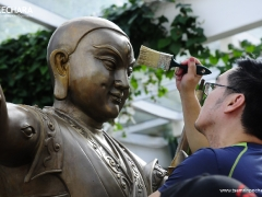 Waxing the sacred face of Dorje Shugden