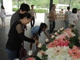 Many also offered flowers to the Buddhas