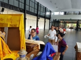 Offering Khata to H.E. the 25th Tsem Tulku Rinpoche's throne and making aspirational prayers and wishes.