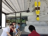 Offering light to Lama Tsongkhapa in front of Wisdom Hall, Kechara Forest Retreat