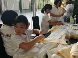 Learning how to fold a khata during the 3N2D kids and teenagers Manjushri Retreat, at Kechara Forest Retreat