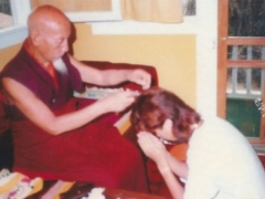 H.H. Kyabje Zong Rinpoche cutting Tsem Rinpoche's hair after Tsem Rinpoche promised to become a monk