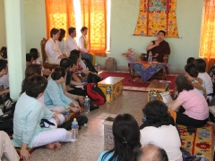 This is me giving a little talk about Gaden, my home monastery, before I showed my students and friends around.
