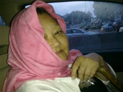 This is my Aunt Matza who visited us from the US. She's keeping her head warm in the car. Cute.