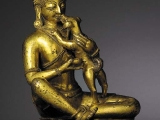 This mahasiddha Kukkuripa is easy to identify as he is accompanied by a small dog whom he loved very much.