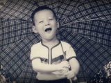 Tsem Rinpoche as a baby holding an umbrella