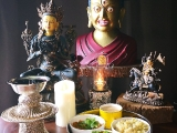 Stunning photo of offerings on my shrine photographed by Victor Choi. The lighting is beautiful. Offerings of food, fruits, drinks, flowers and incense are made on my shrine daily. For me the shrine is a portal to the Enlightened Beings and connecting to their blessings. Blessings to accomplish positive things in my life for others and myself. We do need this connection very much in our unpredictable lives where can experience so much anxiety, pain and a feeling of senselessness. We should never lose our connection to the Enlightened Beings and be firm about it. We will eventually need them no matter how \'good\' things seem now. Today this photograph taken is beautiful and I wanted to share it. 
