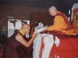 The oracle of Dorje Shugden Choyang Dulzin Kuten of Gaden making offerings to Kyabje Zemey Rinpoche during a teaching in Gaden Shartse Monastery.