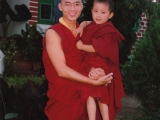 Tsem Rinpoche holding the young incarnation of Zong Rinpoche in Gaden Shartse Monastery.