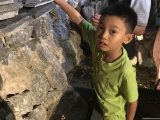 Cute little He Wei working with his dad putting Dorje Shugden mantra stones on the grotto in Kechara Forest Retreat. He is very energetic. Tsem Rinpoche
