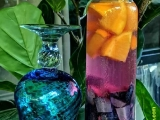Just now, this beautiful grape and orange infused water drink with a blue glass was brought in for me. I was amazed at the colors. Tsem Rinpoche