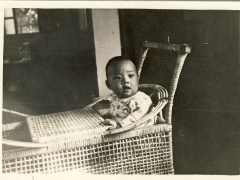 I was very adorable as a child sitting on my rattan throne
