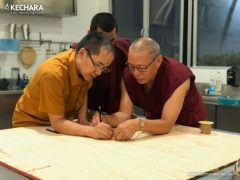 Making the sand mandala which will be placed at the base of the Stupa of the Holy Body.