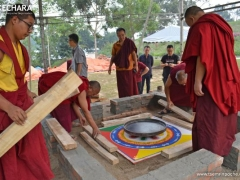 The remaining space in the bottom of the Stupa of the Holy Body is filled with various types of fragrant wood including agarwood, juniper, white sandalwood and red sandalwood. The wood is both an offering and the fuel for the fire.