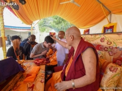 Guests make offerings to H.E. Kensur Rinpoche and the assembly of sangha, and receive their blessings.