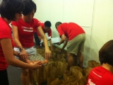 KSK Penang volunteers packing goodies before food distribution. Patsy