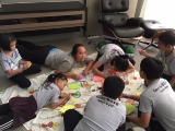 The young participants of W.O.A.H Camp are concentrated in writing messages to their parents&loves one. KSDS, Alice Tay