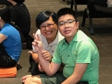 Teacher Victoria showing great care to KSDS student Aaron Tan.  Grace KSDS