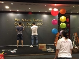 The design team is busy decorating the stage for the KSDS Mid Autumn Festival Charity Dinner. Lin Mun KSDS