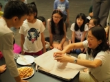 Children were so excited listening to teacher Grace instruction in making Halloween's cookies. Lin Mun KSDS