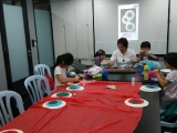 Teacher Alice is guiding children to prepare some artwork for year end art exhibition. Lin Mun KSDS