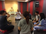 Pastor Tat Ming guided a group of KSDS teachers and volunteers doing meditation. Alice Tay, KSDS