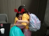 KSDS WOAH Camp - children built up friendship via WOAH camp. Janelle and Charmaine hug each other to bid goodbye before departed KFR.  Grace Tan, KSDS