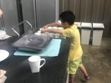 The youngest helper in WOAH Camp 2017 - Royden Lim. He helped out in wiping and arranging the cups. Grace Tan, KSDS