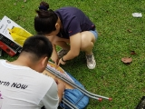 What are Betty and Swee Keong busy with? Answer: removing the iron board cover. KEP-Serena