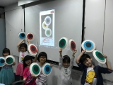 Cheerful kids showed their own artworks happily. Alice Tay, KSDS