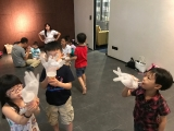 The youngest group of KSDS are so excited to blow up the plastic glove for fun. Alice Tay, KSDS