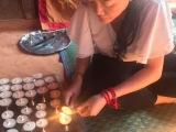 Nepal Pilgrimage 2018 , Picture taken at Sankhu Vajrayogini Chapel , Teacher Grace light on the butter lamp to be offered to Vajrayogini ~ By KSDS Jayce Goh