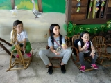 Finally the children getting some rest on some rattan chairs after few hours of connecting with nature and animals. Lin Mun KSDS