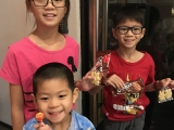 Happy siblings received the cookies and biscuits happily from the teacher.  Alice Tay, KSDS