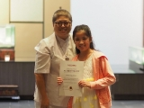 Andrea received her certificate happily from Pastor Gim Lee. Alice Tay, KSDS