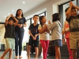 Teacher Melinda is guiding the youngest students to do prostration. Lin Mun KSDS