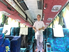Kechara Pastor Tat Ming is conducting a blessing prayer for a traveling tour bus at our holy place, Kechara Forest Retreat. By Pastor Yek Yee, shared by Pastor Antoinette