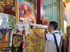JP Thong offering a khata on the throne of His Holiness Kyabje Trijang Rinpoche