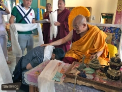 Kensur Rinpoche offers the khata back to Beng Kooi