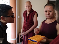 Gen Phende, the new changtso of Trijang Ladrang, makes offerings to Tsem Rinpoche on behalf of Trijang Ladrang