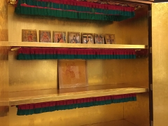 Framed photos of our lineage lamas, Dorje Shugden and entourage, wealth deities, tantric deities and Gyenze