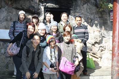 A group picture outside Guru Rinpoche's cave