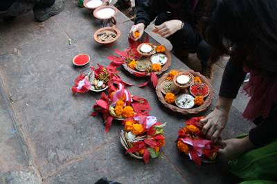 Preparing traditional offerings to offer up to Vajrayogini