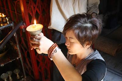 Fiona making a butterlamp offering to Vajrayogini