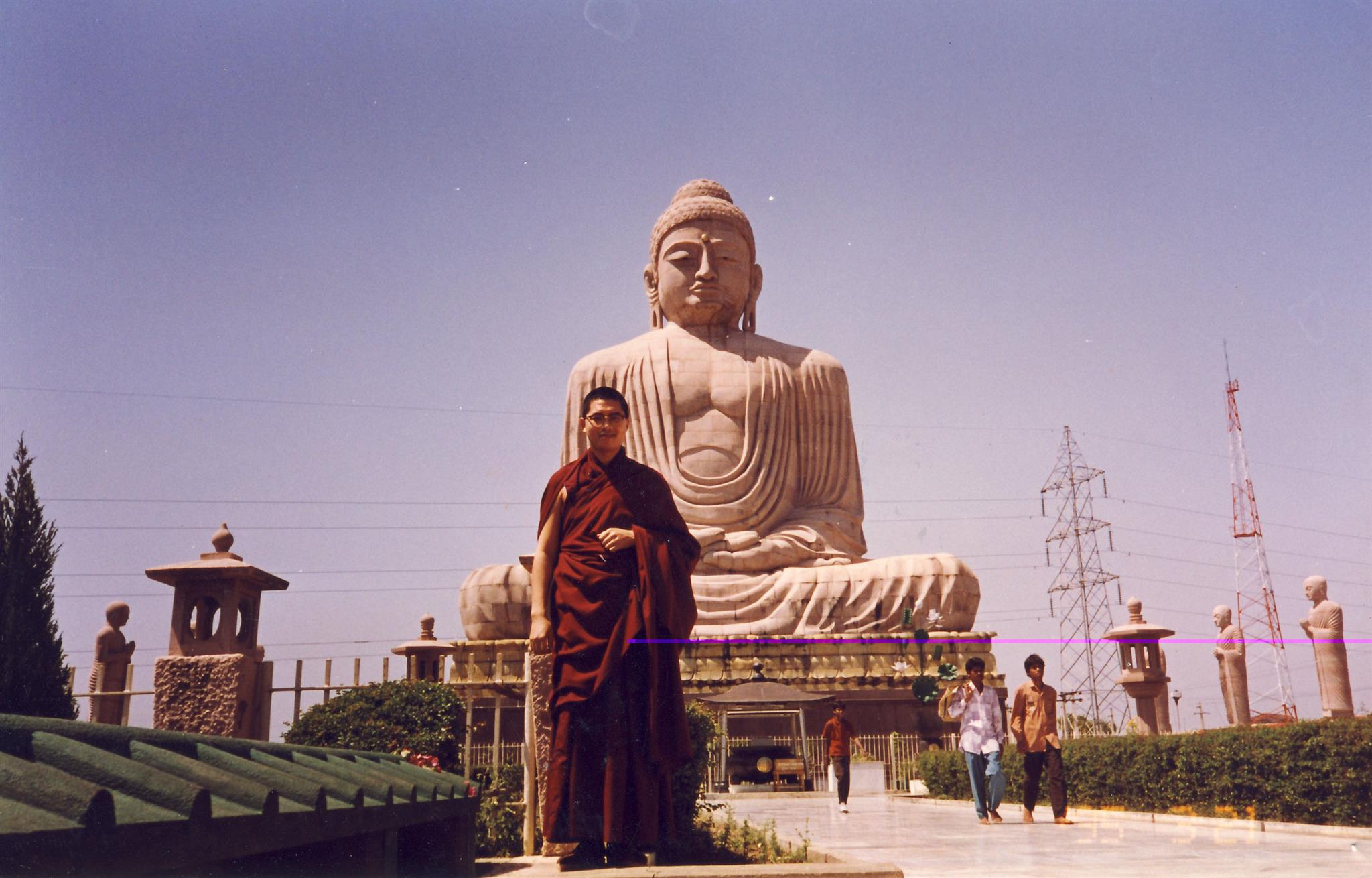 In front of the Great Buddha statue at Bodhgaya, which is 25m tall, made of stone and was consecrated in 1989. Click on image to enlarge.